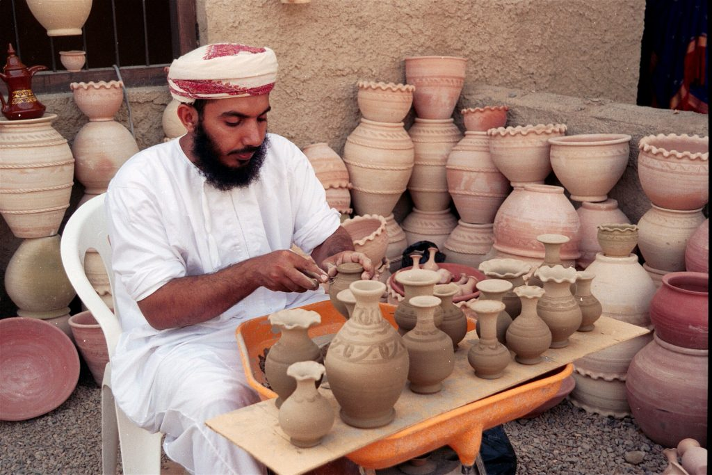 Heritage and crafts Omani man doing pottery design Oman