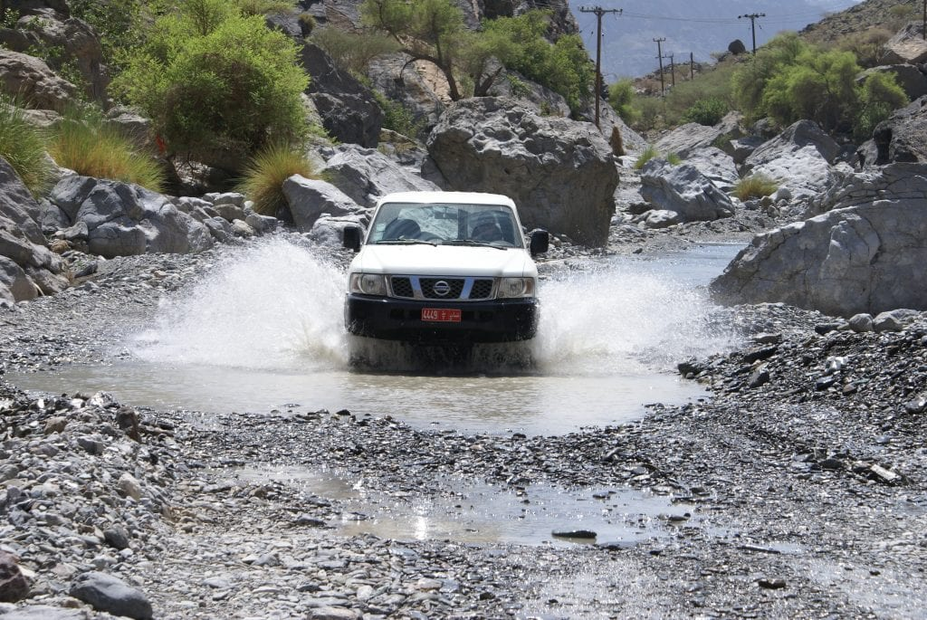 Wadis Car passing through a Wadi in Oman