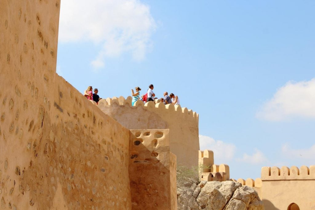 a group of tourists having a trip to Nakhl fort